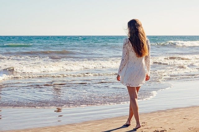 A person standing in front of a beach